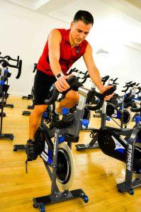 gym goer on a spinning bike